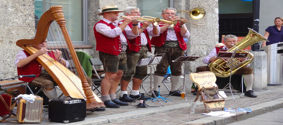 Strains of traditional folk music fill the heady Salzburg air